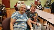 Adam Yates, right, volunteers at a local nursing home in Beaver County. Adam is a fifth-grader at Commonwealth Charter Academy.