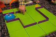 The Code and Go Mouse Robot is equipped with several buttons to determine its distance and direction, and the user needs to map out how to program the mouse to navigate obstacles and reach its target: a piece of cheese.