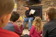 CCA COO Thomas Longenecker read to students at the Read Across America Day event