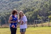 CCA parent Melody Heller of Duncannon, left, and her daughter, Ashley, talk about flying a drone as part of a new summer course at CCA.