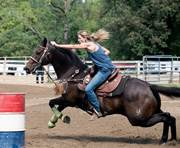 Anika Althouse is a special education teacher at CCA's Family Service Center in Dickson City. Althouse and her horse recently competed in barrel racing at NBHA world championships.